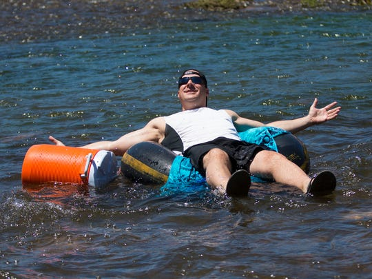 A tuber floats on the Salt River in the Tonto National Forest on Sunday, May 17.