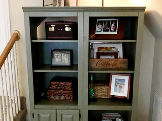 Karen Stewart painted her entertainment center and