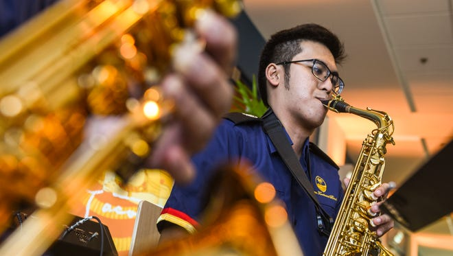 Alto saxophonist Anthony Cariño and other Guam Territorial Band Society members perform holiday and 1930s-themed music, reminiscent of the era of artist Paul Jacoulet, at the Guam Museum on Saturday, Jan. 6, 2018.