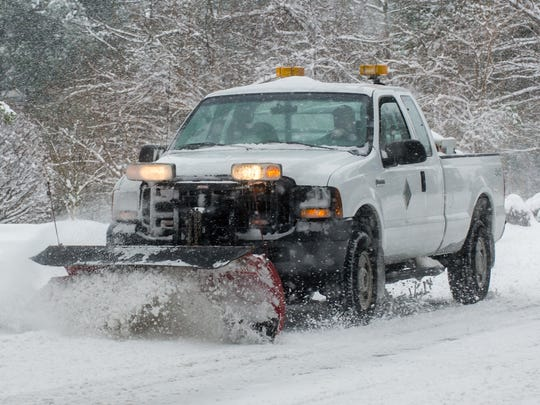 A Wicomico County plow truck drives on Schumaker Ln on the morning of Monday, Feb 15 in Salisbury.