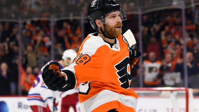 Flyers captain Claude Giroux notched a hat trick in Saturday's win over the New York Rangers that clinched a playoff spot.