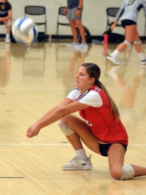 McPherson junior Lauren Labertew digs out a ball during play Saturday at the Newton Invitational.