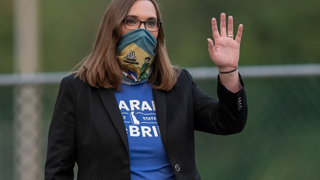FILE - In this Tuesday, Sept. 15, 2020 file photo, transgender activist Sarah McBride, campaigns for a seat in the Delaware Senate in Claymont, Del. McBride won her state Senate race with more than 70% of the vote and will become the first openly transgender state senator in the country.