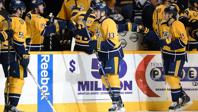 Nashville Predators forward Colin Wilson (33) is congratulated by his teammates after scoring a goal against the Detroit Red Wings in the first period.
