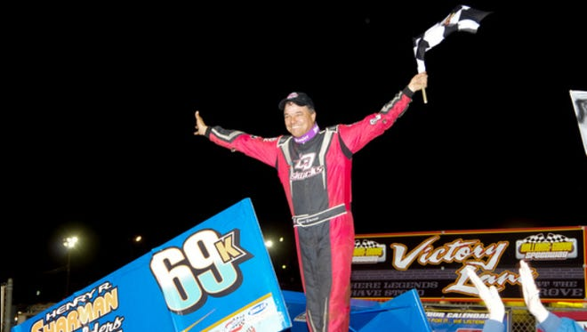 Lance Dewease celebrates after taking the Kreitz No. 69K Sprint car to victory last Friday at Williams Grove, beating the World of Outlaws gang for the Pa. Posse.
