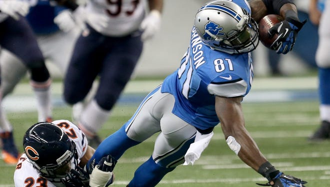 Detroit Lions Calvin Johnson makes a catch against  the Chicago Bears Kyle Fuller during first half action on Thursday, November 27, 2014 at Ford Field.