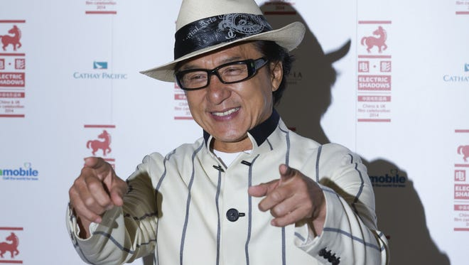 Hong Kong actor Jackie Chan poses for photographers at a special screening of his film, Chinese Zodiac in central London on August 12, 2014. AFP PHOTO / JUSTIN TALLISJUSTIN TALLIS/AFP/Getty Images