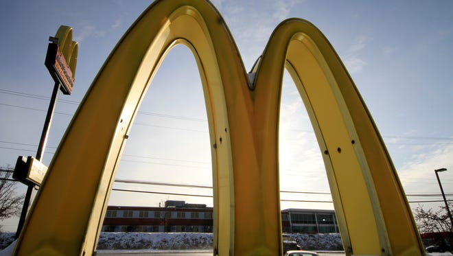 This Tuesday, Jan. 21, 2014, file photo shows McDonald's restaurant's golden arches in Robinson Township, Pa.