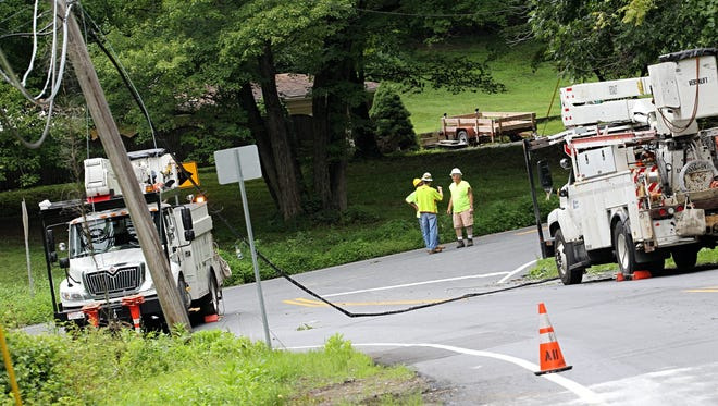 Crews were working to repair downed power lines that closed Stoney Batter Road on Thursday morning.