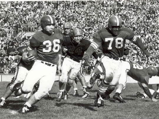 MSU football great Don Coleman (No. 78) pulls to make