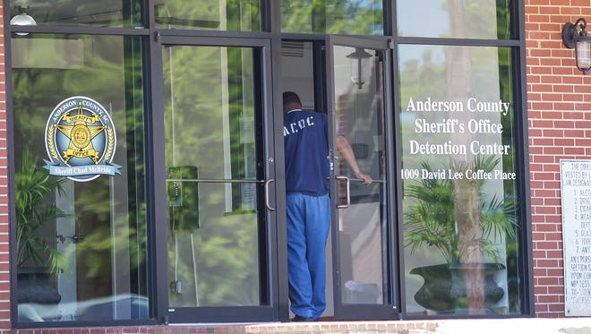 An inmate walks in the front door of the Anderson County Detention Center in Anderson on Monday.