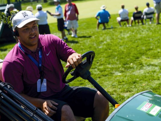Tyler Massar, a Lebanon native and 2012 Cedar Crest graduate, drives a golf cart as part of his work for Fox Sports during the 2015 U.S. Women's Open at Lancaster Country Club.