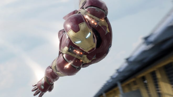 "In this image released by Disney, Iron Man, portrayed by Robert Downey Jr., appears in a scene from ""Captain America: Civil War."""