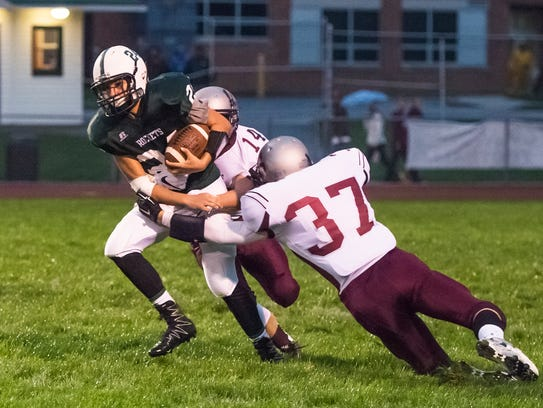 James Buchanan's Colby Bradshaw (24) tries to break