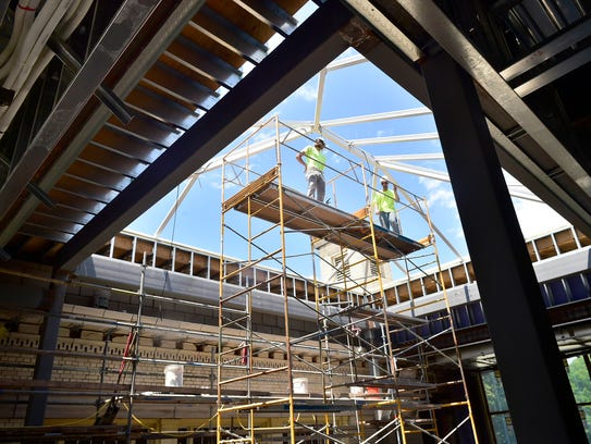 Work continues at the  Coyle Free Library on Wednesday,