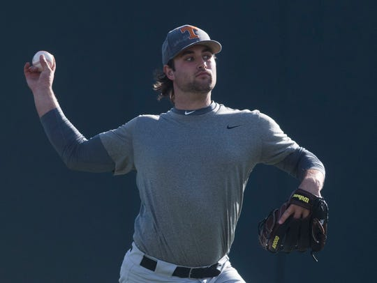 University of Tennessee baseball pitcher Garrett Stallings warms up during practice at Lindsey Nelson Stadium on Friday, Jan. 26, 2018.