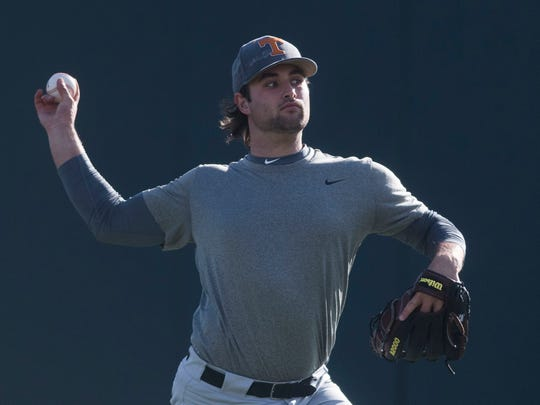 University of Tennessee baseball pitcher Garrett Stallings warms up during media availability in Lindsey Nelson Stadium on Friday, Jan. 26, 2018.