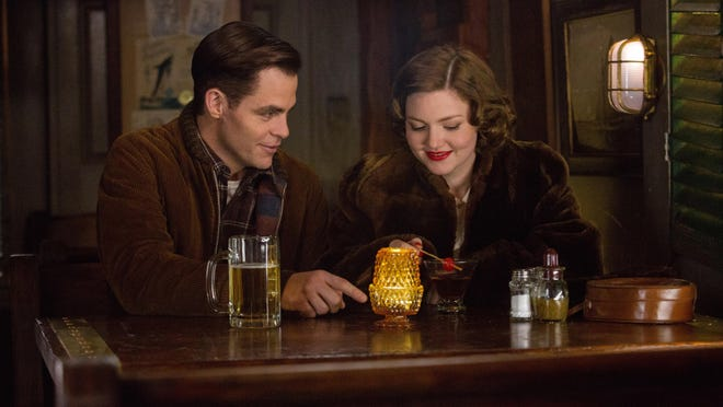 """Chris PIne, left, and Holliday Grainger appear in a scene from """"The Finest Hours."""""""