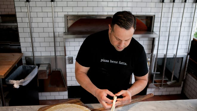 Vincenzo Barone says the dough makes Bricco's pizza stand out. Made only from flour, water, sea salt and yeast, it's then baked in a coal-fired oven (above) that ranges from 900 to 1,000 degrees.
