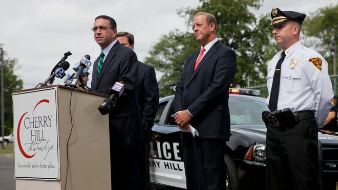 Assemblyman Paul D. Moriarty (D) speaks about new cameras for officers of the Cherry Hill Police Department during a press conference as Cherry Hill Mayor Chuck Cahn, second from right, and Cherry Hill Police Chief William P. Monaghan look on, Thursday, September 11, 2014 in Cherry Hill.
