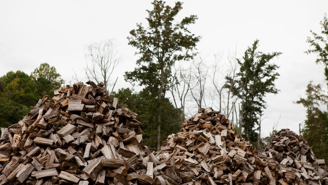 Stacks of chopped wood are seen at a farm owned by the Ormsby family, Wednesday, September 24, 2014 in Williamstown.