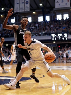 Butler guard Paul Jorgensen (5) drives on Providence forward Rodney Bullock (5) in the first half of an NCAA college basketball game in Indianapolis, Saturday, Feb. 17, 2018.