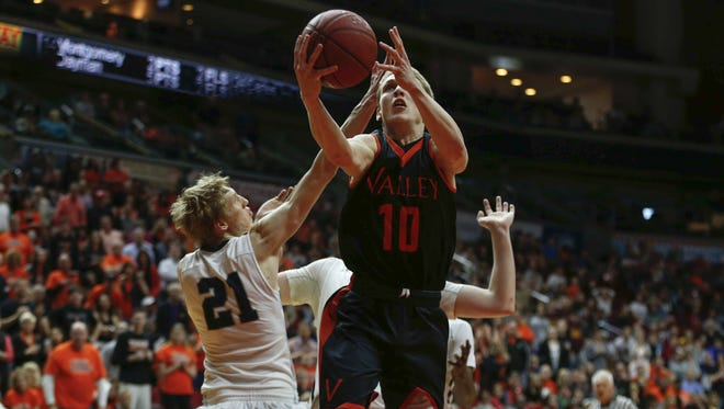 West Des Moines Valley senior Turner Scott runs up a shot against Pleasant Valley on Friday, March 11, 2016, at Wells Fargo Arena in Des Moines.