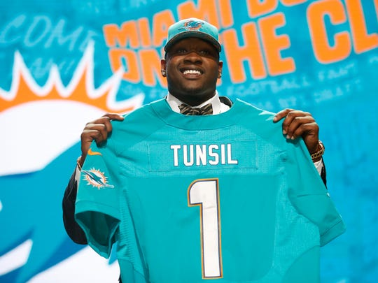 Laremy Tunsil (Mississippi) is selected by the Miami Dolphins as the No. 13 overall pick in the first round of the 2016 NFL Draft at Auditorium Theatre.