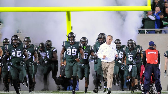 MSU head coach Mark Dantonio leads his team out on to the field to take on Oregon Saturday night at Spartan Stadium. MSU won the big one, cleared a major hurdle. Not its maturity and focus will be tested.