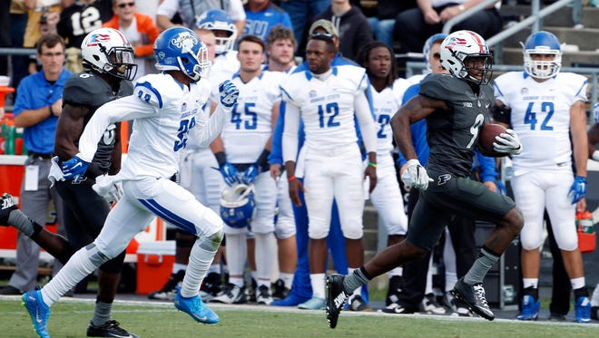 Purdue Boilermakers cornerback Anthony Brown (9) makes a first down on a fake punt play against Indiana State Sycamores defensive back Lonnnie Walker (33) at Ross Ade Stadium. Purdue defeats Indiana State 38-14.