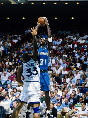 Unknown date; Orlando, FL; USA; FILE PHOTO; Minnesota Timberwolves forward Kevin Garnett (21) attempts a shot against Orlando Magic forward Derek Strong (33) at the Orlando Arena.
