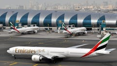Emirates planes are seen at Dubai International Airport