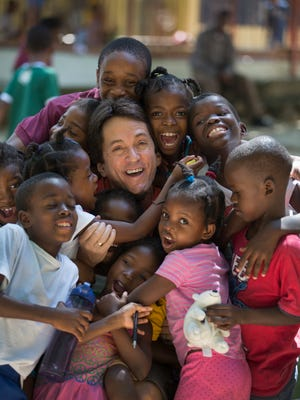 Mitch Albom and some of the children he is caring for at The Have Faith Haiti Mission in Port-au-Prince, on Nov. 2.