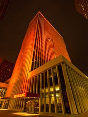 The Financial Center, 666 Walnut Street, is lit orange for Multiple Sclerosis Awareness Week in this 2015 file photo.