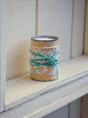 Recycle a can into a pretty candle with rustic style.