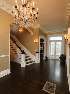 The foyer has ornate moldings, 13-foot ceilings and a central staircase to the upper floors. Homeowner Dan Erck remembers celebrating their first Thanksgiving in the house with a sit-down dinner at a long table in the center hall that comfortably sat 32 people.