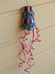 Create a festive windsock with a paper cup and curling