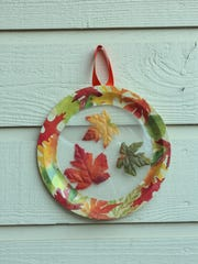 Make a suncatcher with items collected on a nature walk and a few simple supplies from the dollar store.