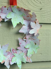 For a long-lasting autumn wreath, create leaf rubbings with crayons and paper.