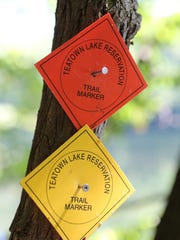 The trail marker at top is for  the newly opened Twin Lakes Trail, a 2.3 mile loop, at Teatown Lake Reservation in Ossining, Sept. 17, 2015.