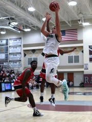 Chino Hills and Jonesboro basketball action on Tuesday during the MaxPreps Holiday Classic Open Division semifinals on Tuesday at Rancho Mirage High School.