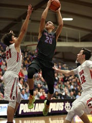 South Salem's Khalid Thomas is a finalist for the All-Mid-Valley boys basketball player of the year.