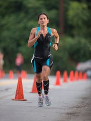 A participant runs in the 5K portion of the Asheville Triathlon last year. The sprint triathlon is Sunday, July 17.