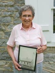 Chambersburg area school historian Joan Bowen holds
