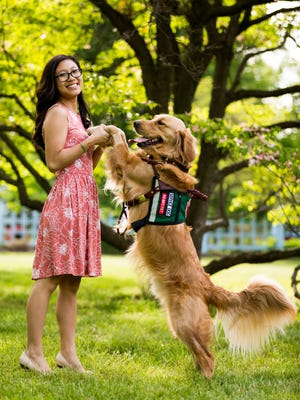 Chiou with her service dog, Collins.