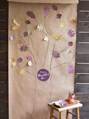 """A paper """"thankful tree"""" is a whimsical addition to Thanksgiving dinner decorating, said crafter Lia Griffith, but it's also a great way to keep kids busy during meal preparation and help them focus on the real meaning of the holiday. Griffith offers downloadable leaf patterns and a printable sign for the center at her website."""