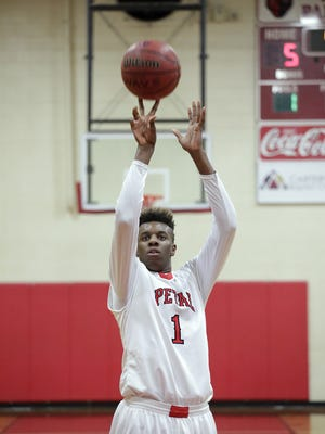 Petal player Tirus Smith (1) shoots a free throw during a game against Brandon at Petal High School Friday, January 8, 2016.
