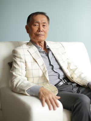 George Takei poses in his New York City apartment on Aug. 12, 2014.