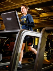 Army Reserve Sgt. 1st Class Joy Clark runs on the treadmill