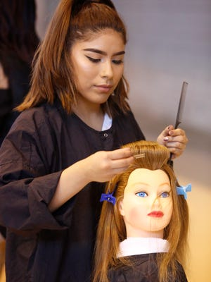 Cindy Zuna of Pleasantville works on her entry during a cosmetology competition at the Skills USA event at Rockland Community College in Suffern on Jan. 19, 2017.